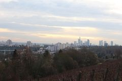 View of the Frankfurt Skyline from the Lohrpark. Lohrberg is located within the Lohrpark right outside of Frankfurt. The Lohrberg `mountain` is the highest point Royalty Free Stock Photo