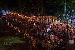 Loi Krathong festival in Chiang Mai. People letting their krathongs to float on the river during the 2017 Loi Krathong festival in Chiang Mai, Thailand Royalty Free Stock Image