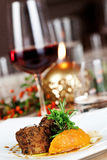 Loin of lamb with juniper and spicy pumpkin Royalty Free Stock Images