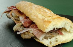 Loin sandwich with ham stock photography