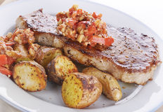 Loin Steak with Potatoes and  Sauce Stock Photos