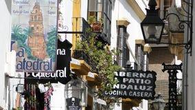 A loja assina dentro Córdova, Espanha Fotos de Stock Royalty Free