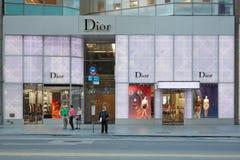 Loja de Christian Dior no crepúsculo na 57th rua, em New York Imagem de Stock