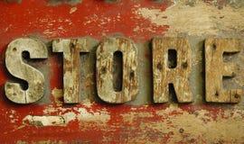Loja de madeira velha da placa Fotografia de Stock Royalty Free