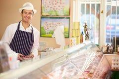 Loja de At Work In do carniceiro Foto de Stock Royalty Free