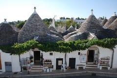 Lojas de lembrança de Alberobello, Puglia Imagem de Stock