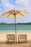 lokaliserad semesterortsjösida för strand stol Arkivbild