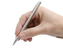 Lokalisiert, die Hand schreibend, die silbernen Stift hält Stockbilder