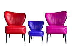 Lokalisiert vom roten blauen rosa oder violetten Lederstuhl auf weißem Hintergrund lizenzfreie stockbilder
