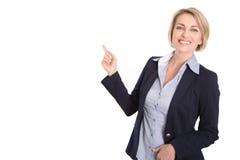 Lokalisierte attraktive blonde Frau, die mit dem Indexfinger auf wh zeigt Lizenzfreies Stockbild