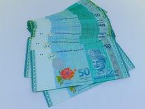 Lokalisierte Banknoten mit einem weißen Hintergrund stockfotos