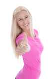 Lokalisierte blonde erfolgreiche Studentin mit dem Daumen oben Lizenzfreies Stockbild