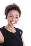 Lokalisierte hübsche Geschäftsfrau, die mit Kopfhörer lächelt stockfotografie