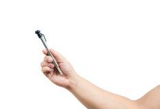 Lokalisierte Hand, die ein Reifenmanometer hält Stockfotos