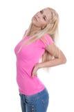Lokalisierte junge blonde Frau mit Rückenschmerzen über weißem Hintergrund Stockbild