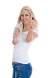 Lokalisierte junge erfolgreiche blonde Studentin mit den Daumen oben an Stockfotos