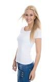 Lokalisierte recht blonde lächelnde Studentin in der zufälligen Kleidung Lizenzfreies Stockbild