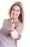 Lokalisierte schöne blonde junge Frau mit den Daumen oben Lizenzfreies Stockbild