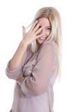 Lokalisierte schelmische junge attraktive Geschäftsfrau auf weißem backgr Lizenzfreies Stockbild
