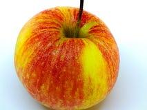 Lokalisierter Apfel mit einem weißen Hintergrund lizenzfreies stockfoto