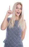 Lokalisierter attraktiver blonder Auszubildender hat eine Idee mit dem Zeigefinger Lizenzfreie Stockfotos