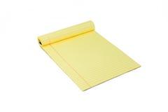Lokalisierter gelber Notizblock im weißen Hintergrund Lizenzfreies Stockbild