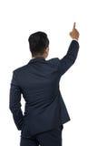 Lokalisierter junger zeigender Geschäftsmann, hintere Ansicht Stockbild