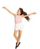 Lokalisiertes Foto des netten lächelnden Mädchens im Rock, der Ballett Pas tut Lizenzfreies Stockfoto