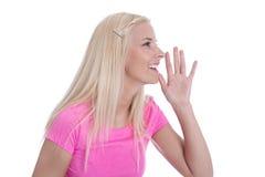 Lokalisiertes junges blondes Frau Nennen. Stockfotografie