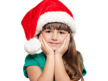 Lokalisiertes Porträt eines kleinen Mädchens in einem Weihnachtshut Stockbild