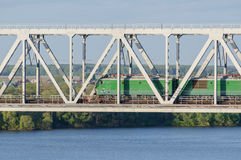 Lokomotiv passing the bridge over the river in summer Royalty Free Stock Images