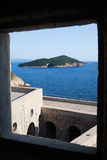 Lokrum Island from Fort Lovrijenac. Framed view on Lukrum island on the Adriatic Sea from Fort Lovrijenac in Dubrovnik, Croatia Royalty Free Stock Photos