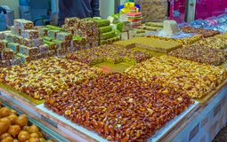 The lokum and gozinaki. The dessert stall offers gozinaki, halva, lokum and other traditional sweets, Turkish bazaar, Akko, Israel Royalty Free Stock Image