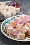 Lokum - turkish delight. Rahat lokum - turkish delight with powdered sugar on a wooden background royalty free stock photo