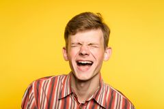 Lol lmfao man laugh joy happy humor cheerful smile. Lol lmfao. man laughing hard. joy happiness humor and wide cheerful smile concept. portrait of a young guy on royalty free stock image
