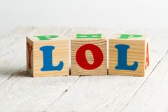 LOL. Sign. Wooden blocks on a white wooden background Stock Photography