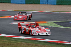 Lola and Osella fighting on the track. Stock Photos