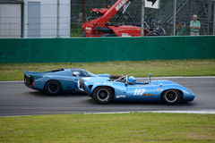 1965 Lola T70 MK1 Spyder overtakes a Chevron B16 Royalty Free Stock Photo
