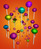 Loli Bg. A group of colorful lollipops scattered on a beautiful orange background Royalty Free Stock Photo