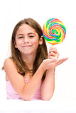 The Lolipop. Young girl showing off her colorful lolipop Stock Images