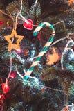 Lolipop on the Cristmas tree Stock Photos