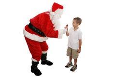 Lolipop from Santa Full Body. Cute little boy receiving a lolipop from Santa.  Full body isolated Royalty Free Stock Images