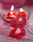 Lolipops and candles in the form of hearts on a pink background. Romantic concept of Valentines Day. Tinted photo. Royalty Free Stock Image