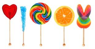 Lolipops - Süßigkeit auf einem Steuerknüppel lizenzfreie stockfotos