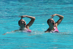 Lolita Ananasova and Anna Voloshyna of Ukraine compete during synchronized swimming duets free routine preliminary of the Rio 2016 Stock Photos