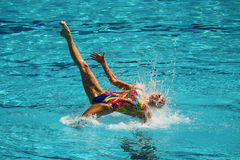 Lolita Ananasova and Anna Voloshyna of Ukraine compete during synchronized swimming duets free routine preliminary of the Rio 2016 Stock Photo