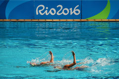 Lolita Ananasova and Anna Voloshyna of Ukraine compete during synchronized swimming duets free routine preliminary of the Rio 2016 Stock Image
