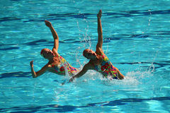 Lolita Ananasova and Anna Voloshyna of Ukraine compete during synchronized swimming duets free routine preliminary of the Rio 2016 Royalty Free Stock Photography