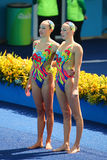 Lolita Ananasova and Anna Voloshyna of Ukraine compete during synchronized swimming duets free routine preliminary of the Rio 2016 Royalty Free Stock Photo
