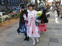 Lolita Fashion Girls Walking Down the Street Royalty Free Stock Images